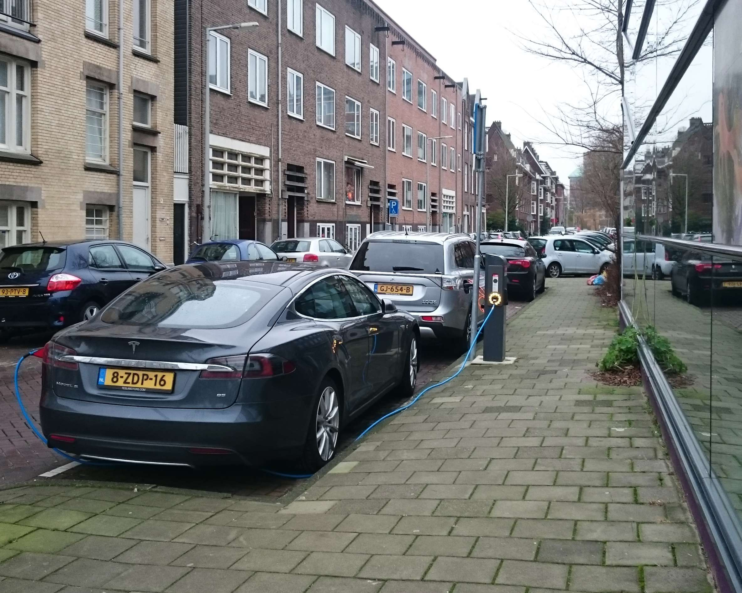 A Tesla vehicle parked on an Amsterdam street. (Image Credit: dmitryelj)