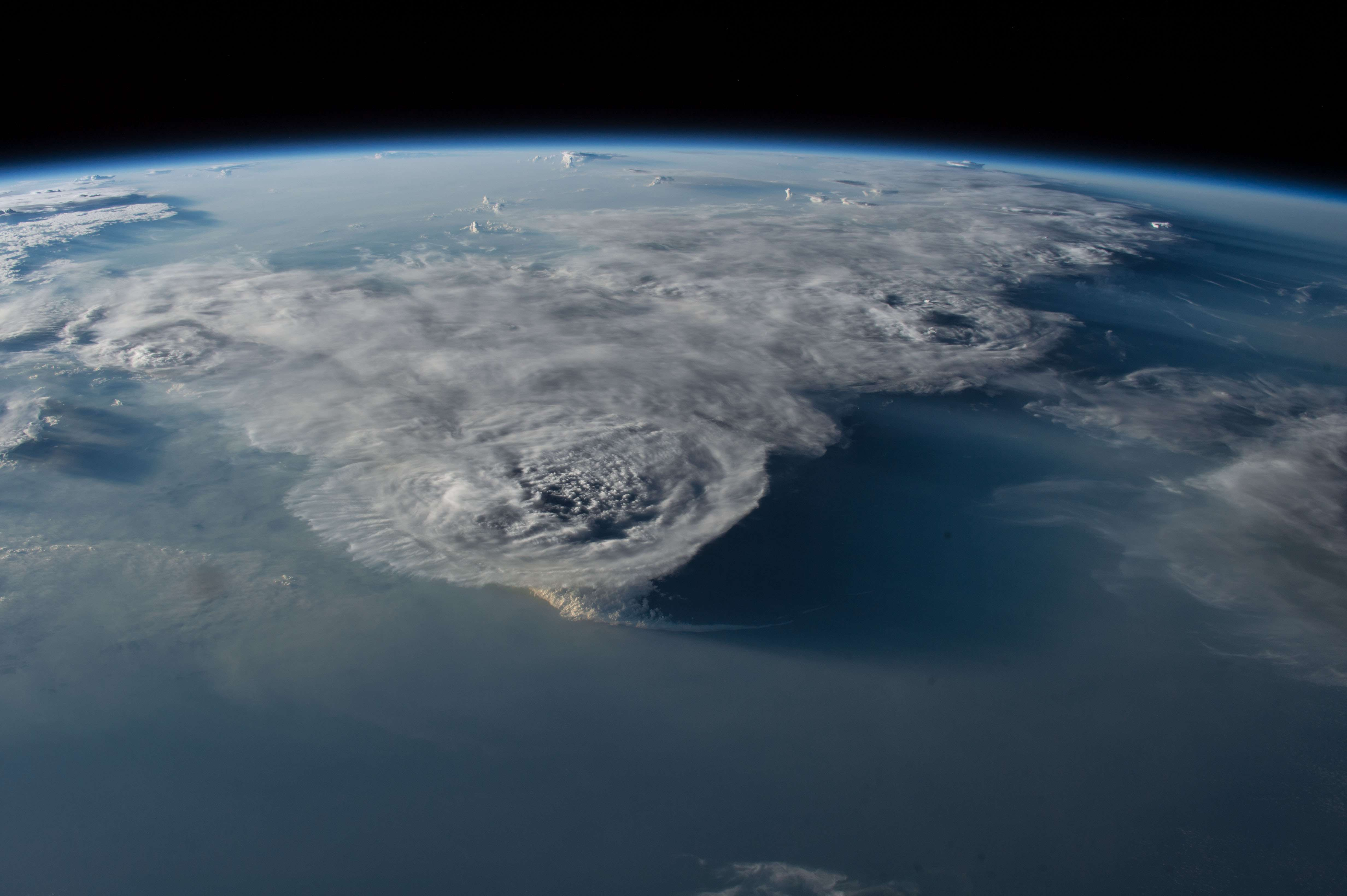 Storm clouds, viewed from the International Space Station, hover over the South China Sea. (Image Credit: NASA)