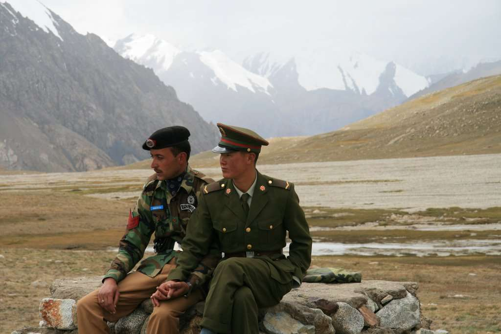 Chinese and Pakistani border guards at the Khunjerab Pass in Pakistan's Gilgit-Baltistan region bordering China. (Image Credit: Anthony Maw/Wikimedia Commons)