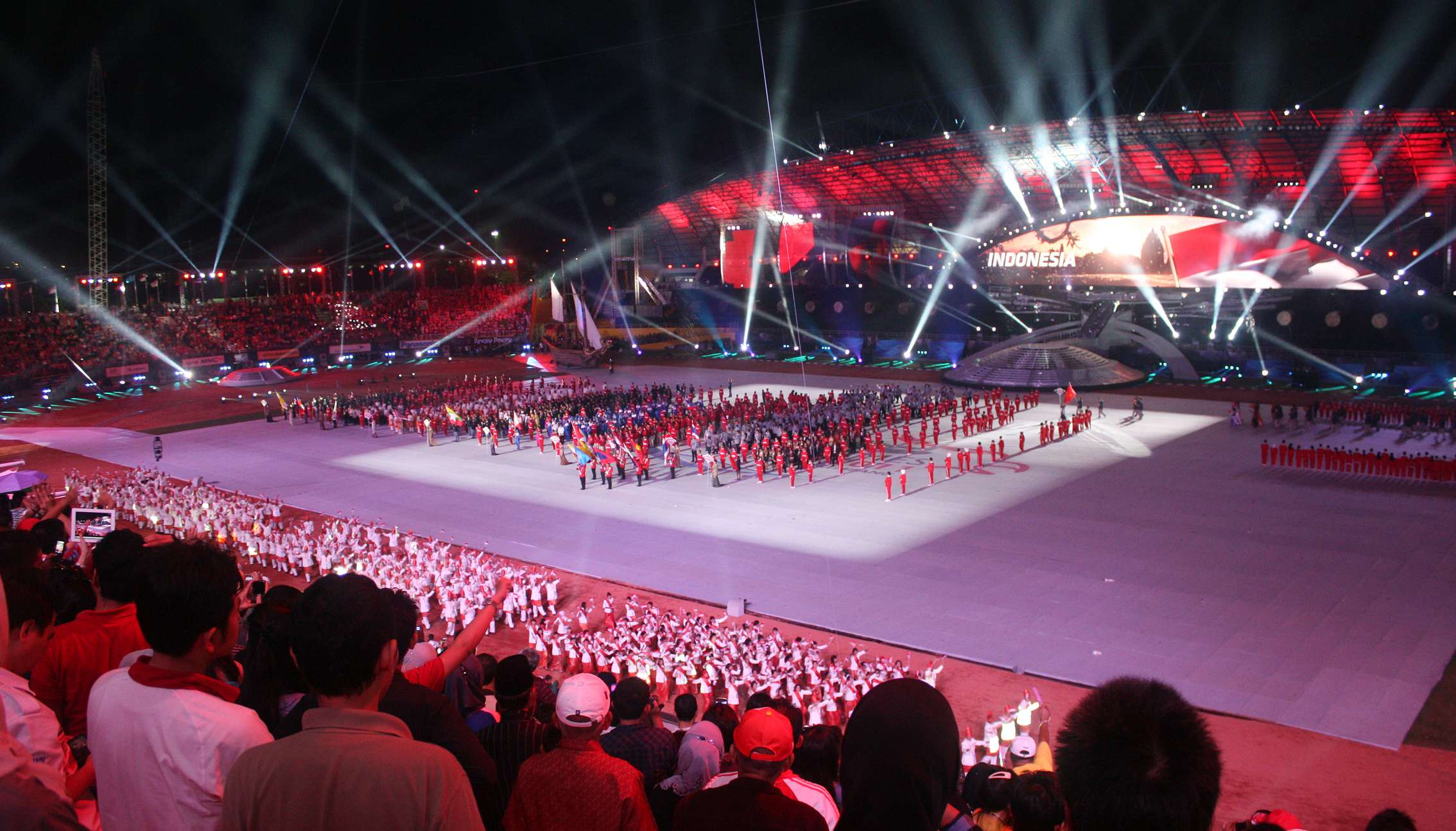 Athletes from host country Indonesia marching in front of honor podium during the 2011 Southeast Asia Games. (Image Credit: Gunawan Kartapranata/Wikimedia Commons)