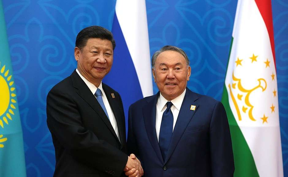 Chinese President Xi Jinping and then-Kazakhstan President Nursultan Nazarbayev shake hands ahead of the meeting of the Council of Heads of State of the Shanghai Cooperation Organisation (SCO) on June 9, 2017. (Image Credit: Kremlin)